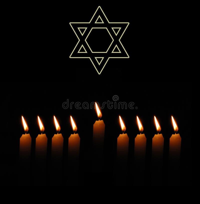 Fondo judío del día de fiesta con la estrella y las velas fotos de archivo