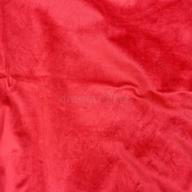 Fondo lacerato rosso caldo del primo piano del tessuto fotografia stock
