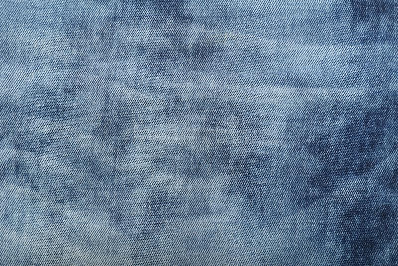 Fondo lavado azul de la textura del dril de algodón de los vaqueros imagen de archivo