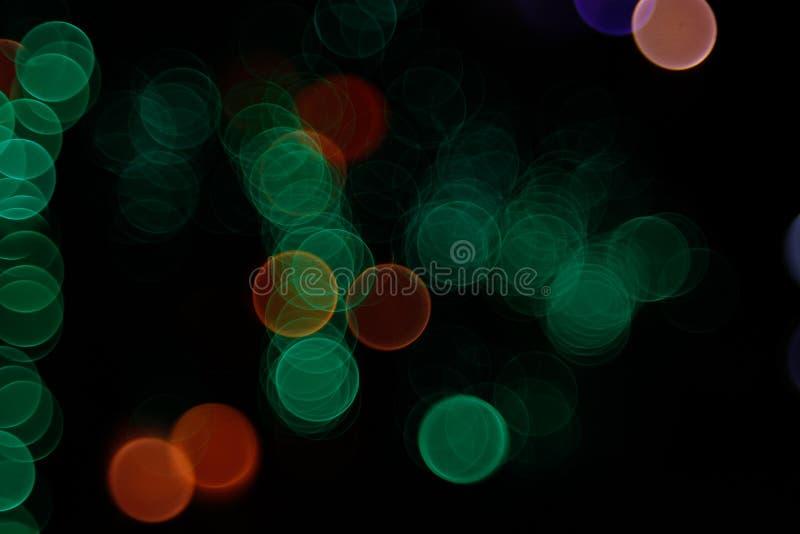 Fondo leggero astratto di Bokeh Immagine della sfuocatura della luce di defocus alla notte royalty illustrazione gratis