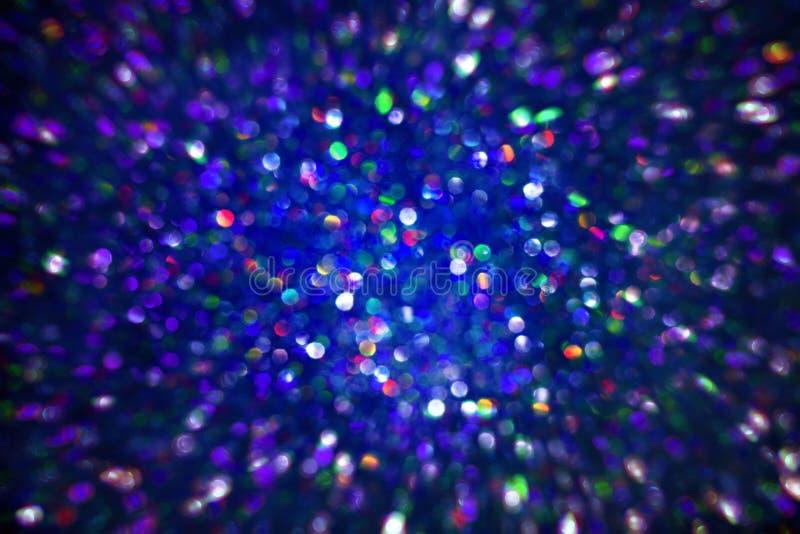 Fondo leggero delle scintille, colore del blu di De Focused Sparkling fotografia stock libera da diritti