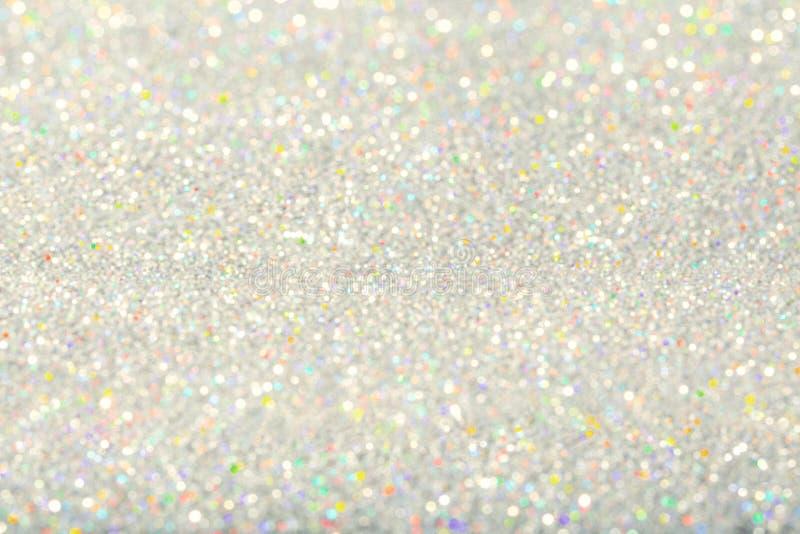 Fondo leggero delle scintille, polvere dell'argento di De Focused Sparkling fotografia stock