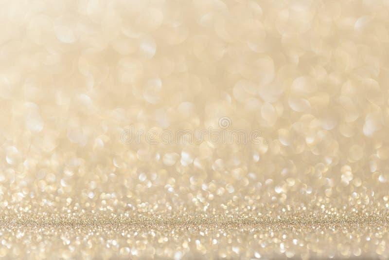 Fondo leggero di scintillio di giallo dell'oro fotografia stock libera da diritti