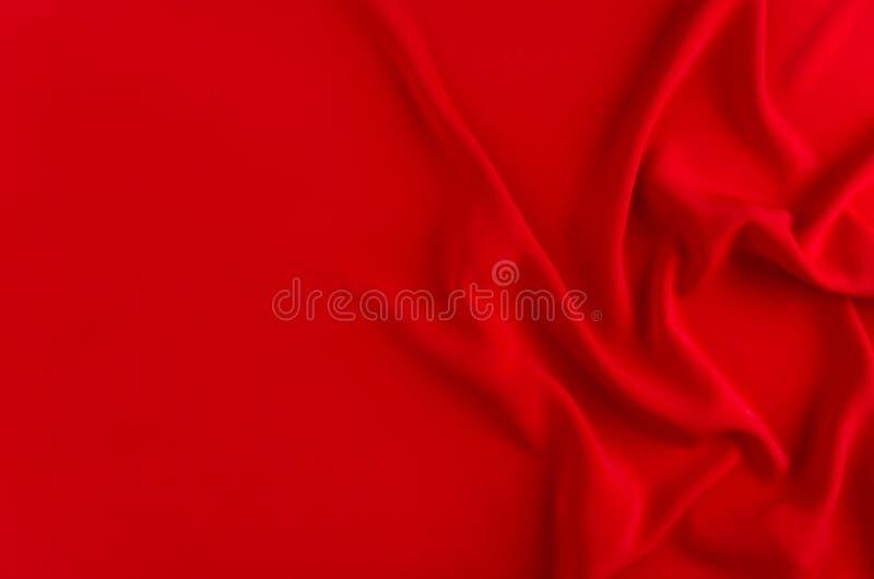 Fondo liso de seda de color rojo oscuro con el espacio de la copia Contexto abstracto del amor fotografía de archivo