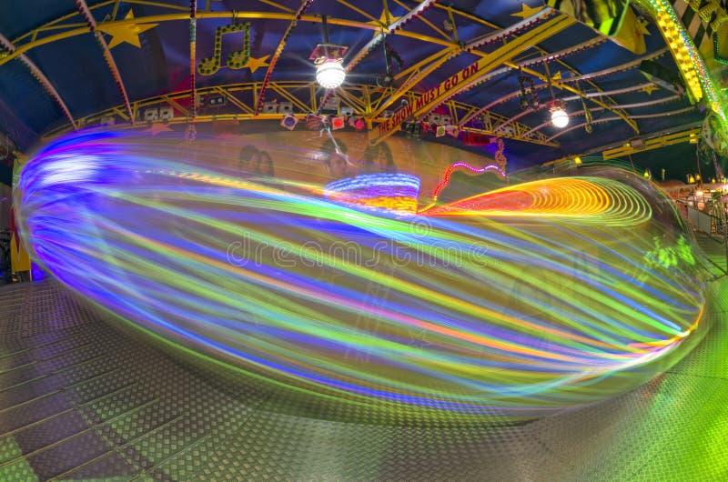 Fondo móvil de las luces de Luna Park del carnaval de la feria de diversión foto de archivo libre de regalías