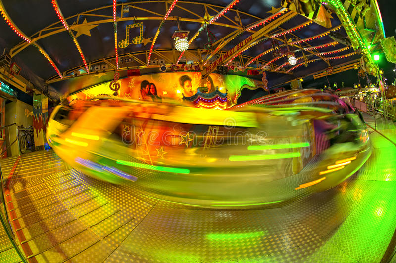 Fondo móvil de las luces de Luna Park del carnaval de la feria de diversión foto de archivo