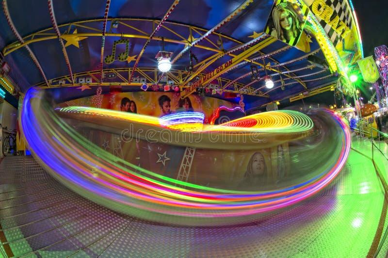 Fondo móvil de las luces de Luna Park del carnaval de la feria de diversión fotos de archivo libres de regalías