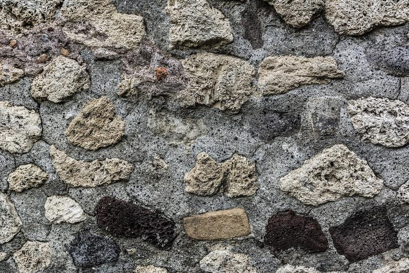 Fondo manchado de la pared de piedras fotografía de archivo