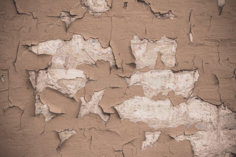 Fondo marrón claro agrietado de la textura de la pared Fondo texturizado Grunge de la pared Textura áspera retra de Brown Pai bei imagen de archivo