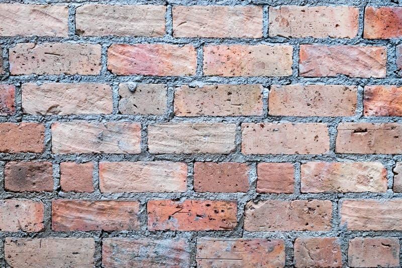 Fondo marrón de la pared de ladrillo foto de archivo