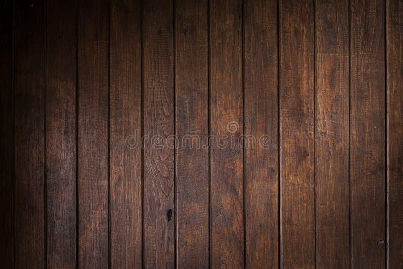 Fondo marrone di legno della plancia della parete immagini stock