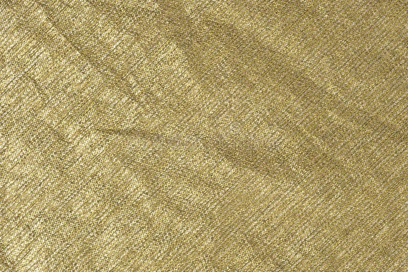 Fondo metálico de la tela del Plata-oro foto de archivo