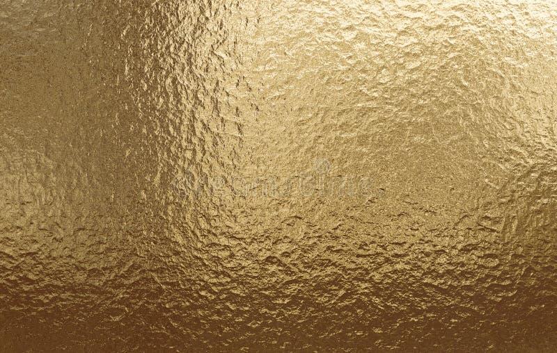 Fondo metallico dell'oro, struttura di tela, fondo festivo luminoso immagine stock libera da diritti