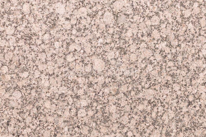 Fondo mineral con textura roja o rosada de la piedra del granito foto de archivo libre de regalías