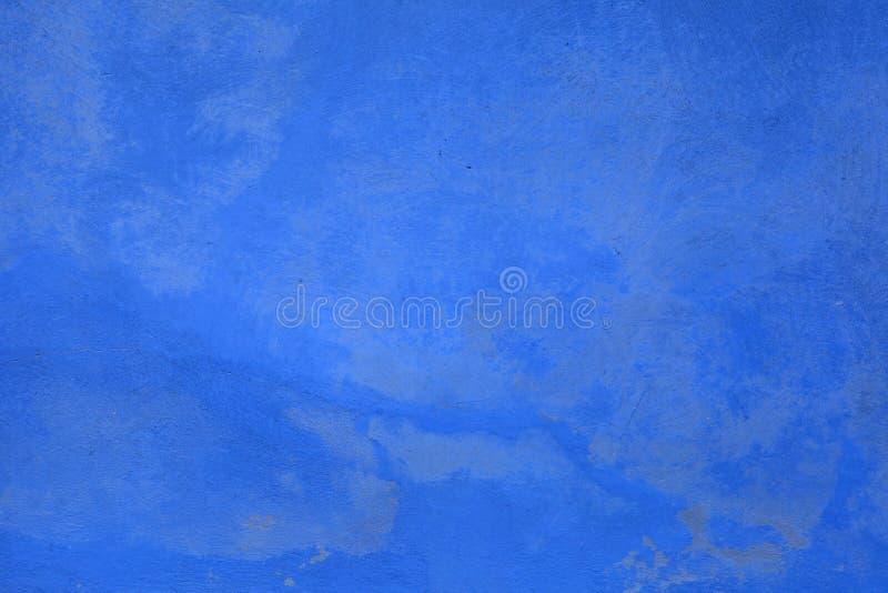 Fondo misero blu dello stucco della pittura fotografia stock