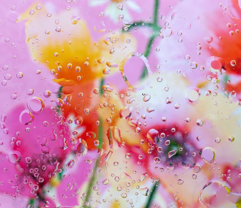 Fondo multicolor debajo del vidrio 1 foto de archivo
