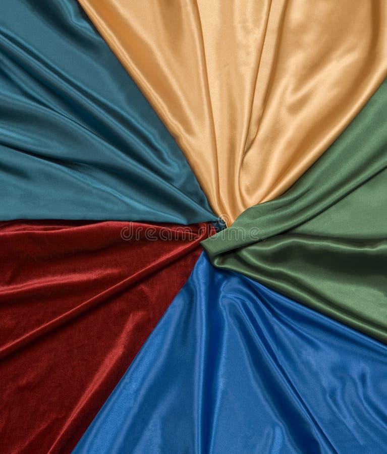 Fondo multicolore del raso immagini stock libere da diritti