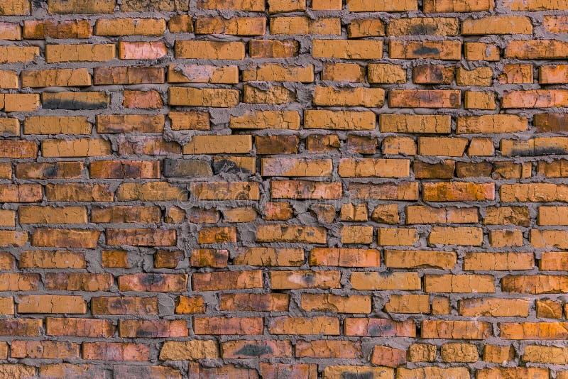 Fondo/muro di mattoni arancio della muratura fotografia stock