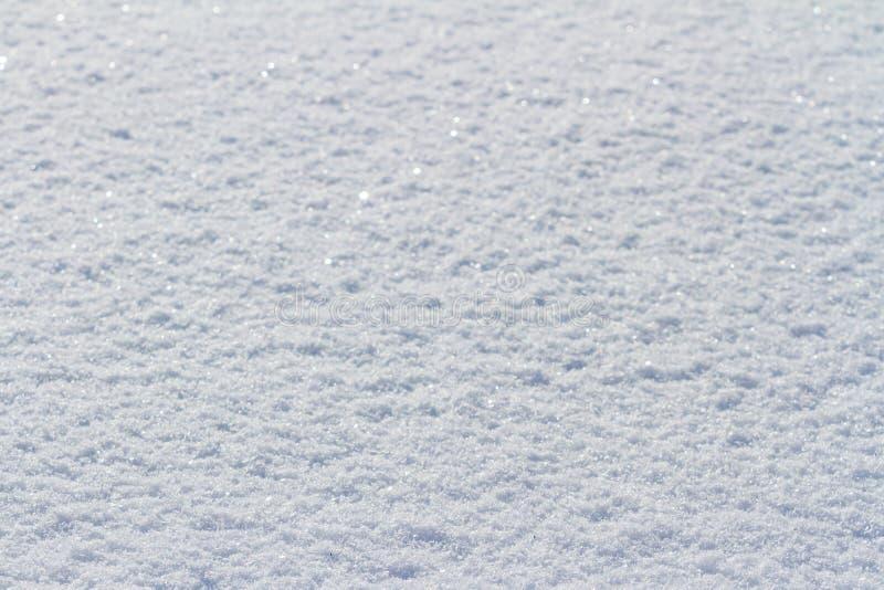 Fondo natural de la textura del invierno con la nieve blanca foto de archivo