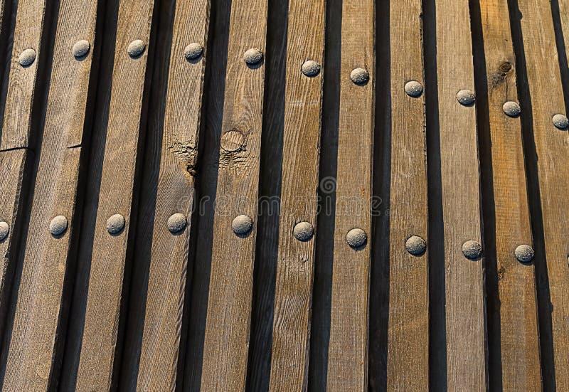 Fondo natural del tablero, textura del metal del remache de la barra vertical de la lona fotografía de archivo