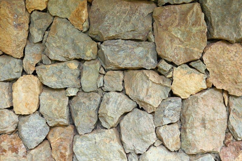 Fondo naturale impilato della parete della roccia del campo fotografie stock