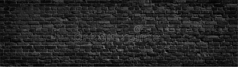 Fondo negro de la pared de ladrillo imagenes de archivo