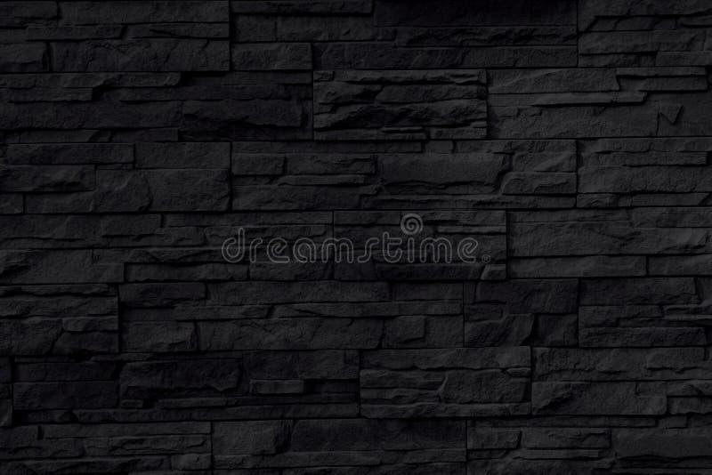 Fondo nero della parete di pietra immagini stock
