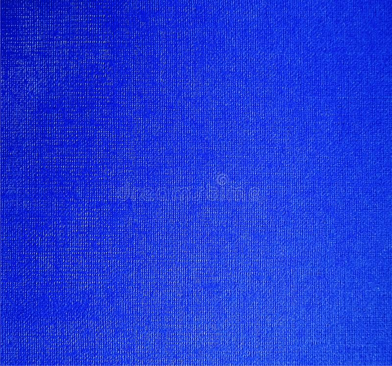 Fondo nero della tela blu Strato di carta della tela fotografia stock