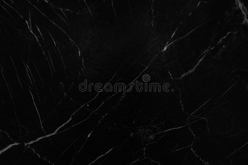 Fondo nero di marmo, contro mattonelle del modello della pietra scura del pavimento, interno grigio naturale di crepuscolo fotografia stock libera da diritti