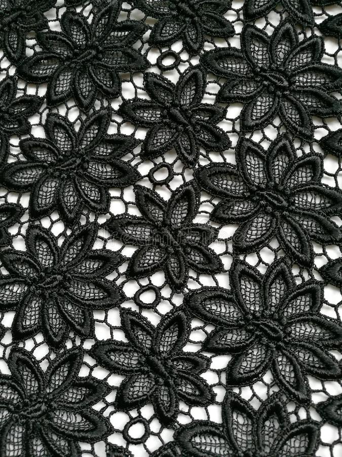 Fondo nero di struttura del pizzo del fiore immagini stock