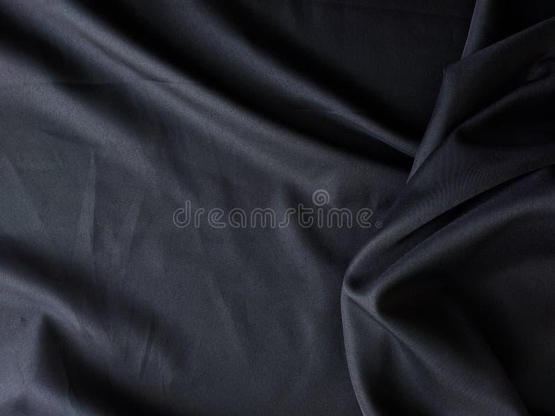 Fondo nero di struttura del tessuto, struttura aggrovigliata del tessuto, fondo di industria tessile immagine stock