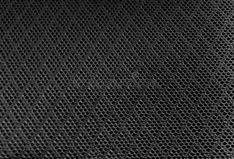 Fondo nero di struttura del tessuto del tessuto di maglia di colore, sport della grata fotografia stock libera da diritti
