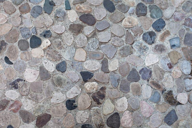 Fondo neutrale del mosaico grigio del ciottolo immagine stock