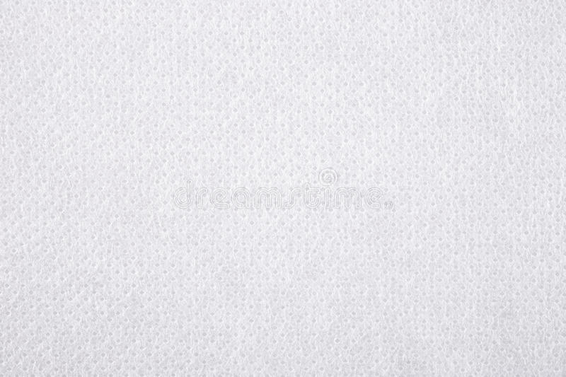 Fondo no tejido blanco de la textura de la tela imagen de archivo