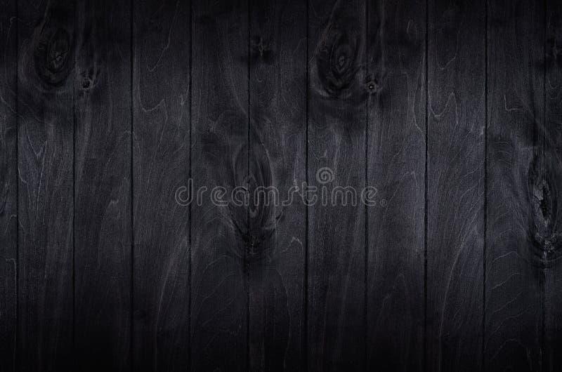 Fondo noir del bordo di legno del nero di eleganza fotografia stock