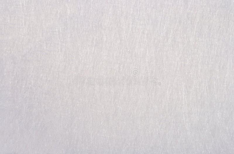 Fondo non tessuto bianco del tessuto fotografia stock libera da diritti