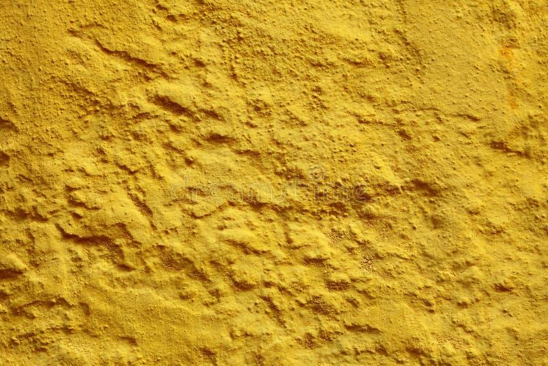 Fondo o struttura giallo della parete della pittura immagini stock