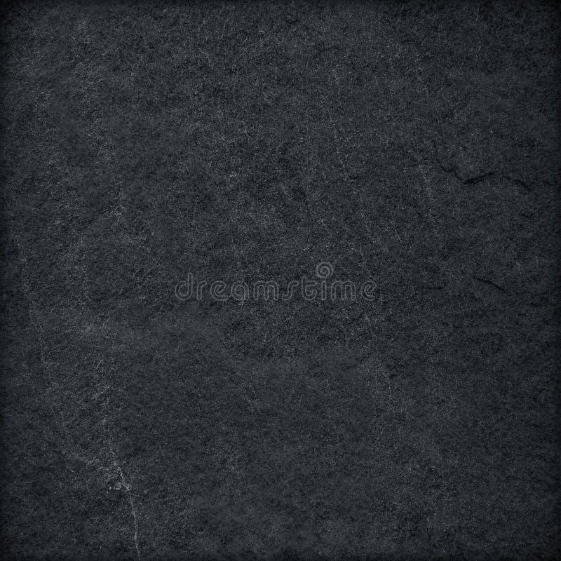 Fondo o struttura nero astratto grigio scuro della pietra dell'ardesia fotografia stock libera da diritti