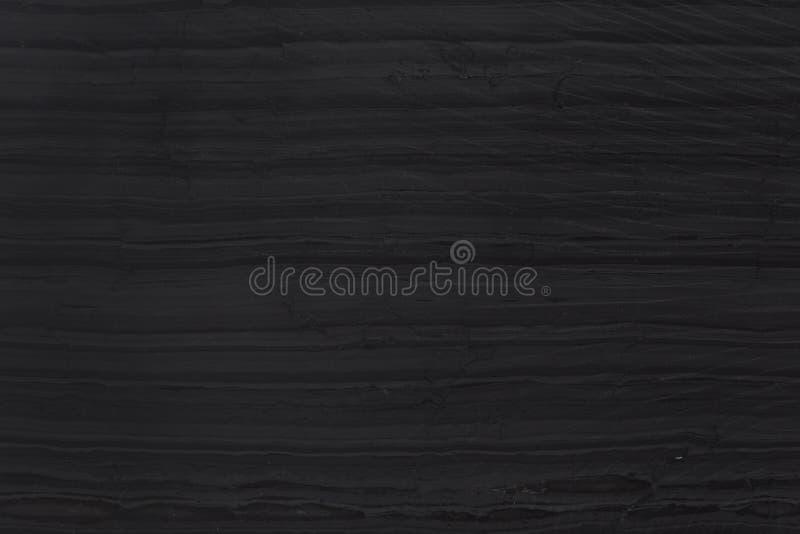 Fondo o struttura nero grigio scuro dell'ardesia Granito fotografie stock