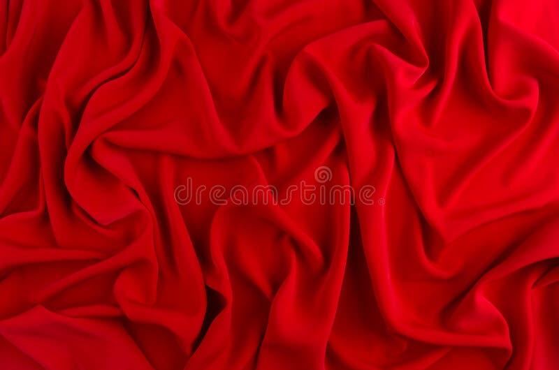 Fondo ondulato di seta rosso Contesto di passione per il giorno di biglietti di S. Valentino fotografia stock