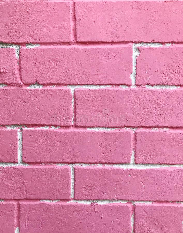 Fondo ordinato rosa pastello di struttura del muro di mattoni, contesto per signora o concetto della donna fotografia stock