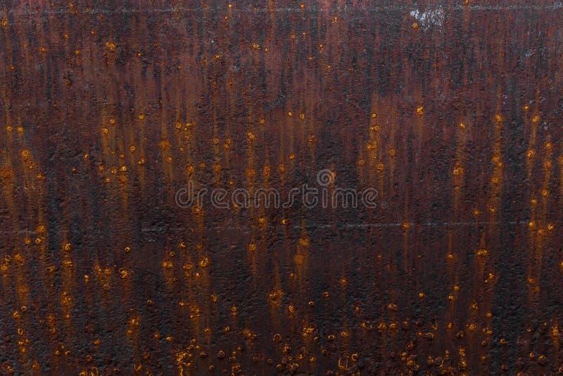 Fondo oxidado Hoja de metal oxidada vieja Pared aherrumbrada roja del garaje Fondo de Brown foto de archivo