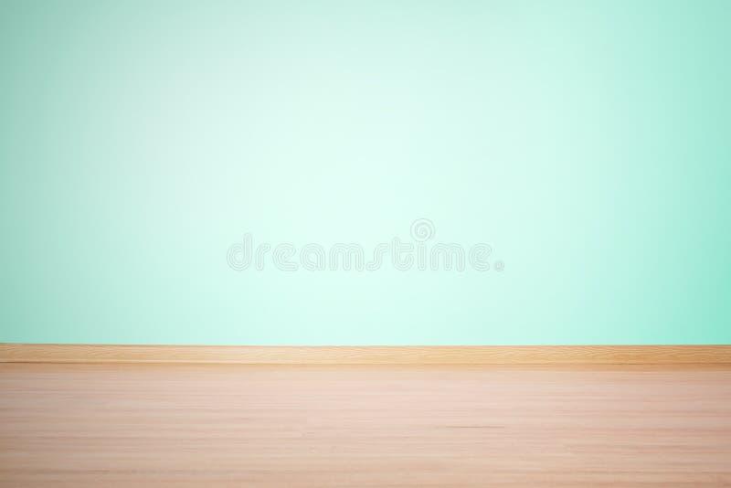 Fondo, parete in bianco e pavimento in un colore verde blu immagini stock libere da diritti