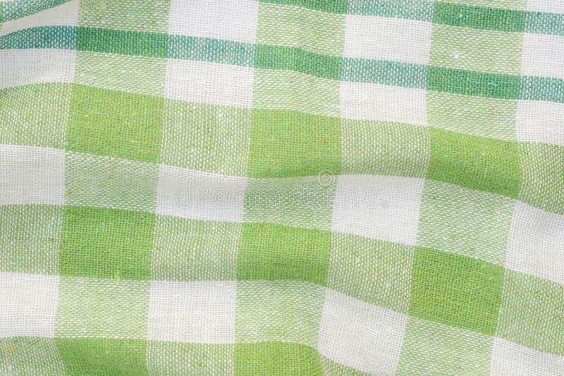Fondo piegato a quadretti verde e bianco dell'asciugamano di cucina fotografia stock libera da diritti