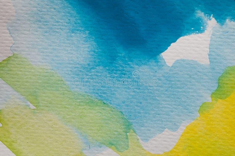 Fondo pintado a mano de la acuarela Movimientos amarillos y azules del cepillo de la acuarela en el papel texturizado libre illustration