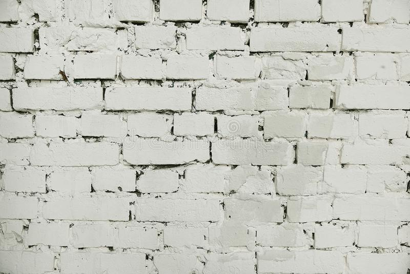 Fondo pintado viejo blanco de la pared de ladrillo imagen de archivo