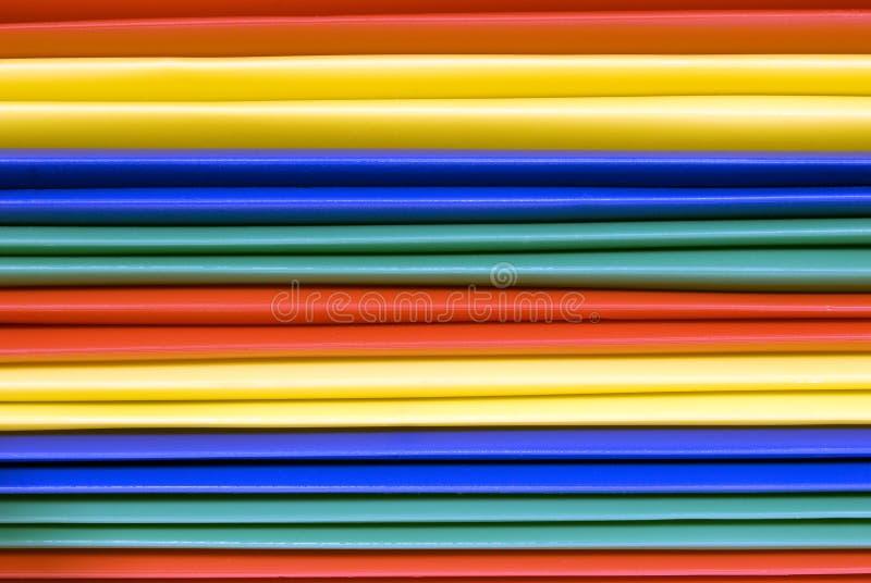 Fondo plástico brillantemente coloreado de las carpetas de archivos foto de archivo libre de regalías