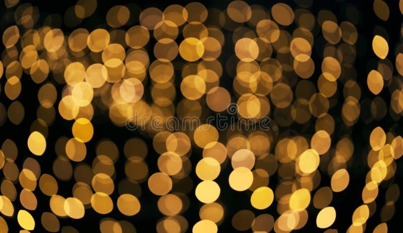 Fondo que brilla defocused del extracto Bokeh borroso de luces de oro Concepto de la Navidad y del d?a de fiesta imagen de archivo