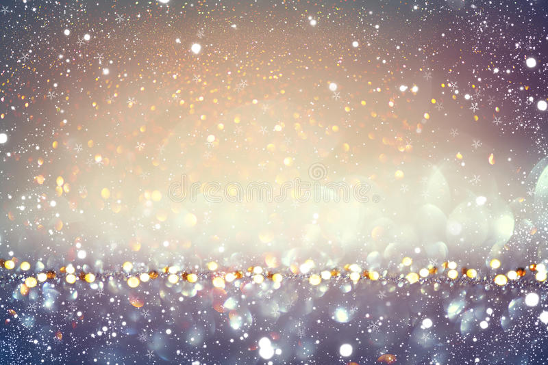 Fondo que brilla intensamente del día de fiesta de oro de la Navidad imagen de archivo