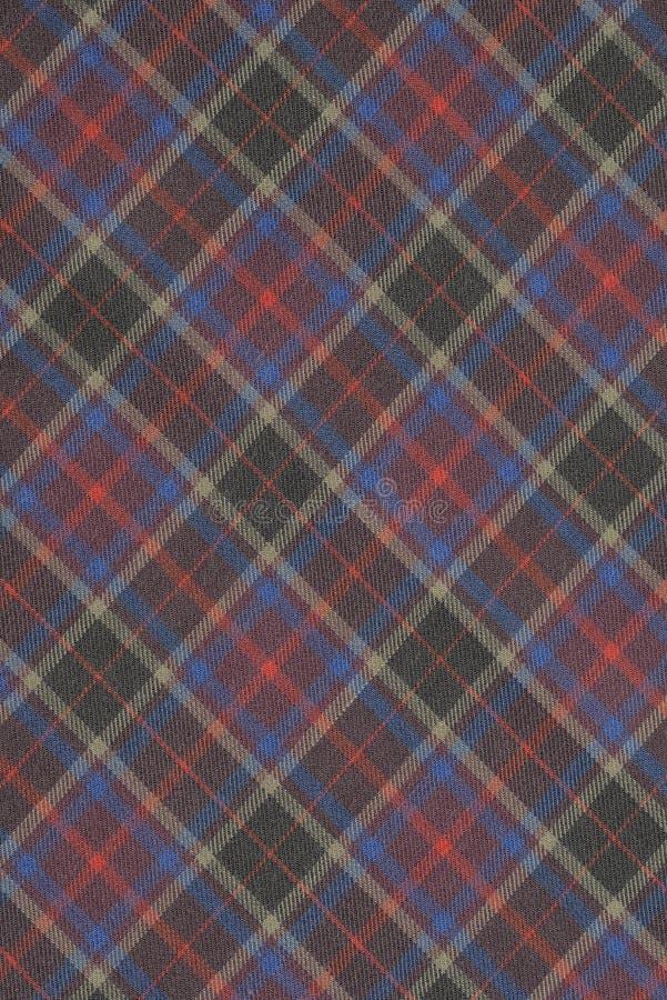 Fondo rojo, azul, púrpura y amarillo del paño de la tela escocesa fotos de archivo